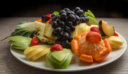 slices of fresh fruit with grapes and pineapple