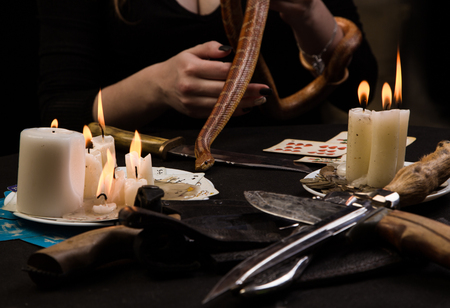 Witch to conduct a voodoo ritual with the snake
