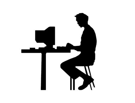 Black silhouette the m�n typing at a computer