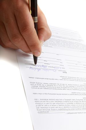 Image of a person signing the model release Stock Photo - 5727075
