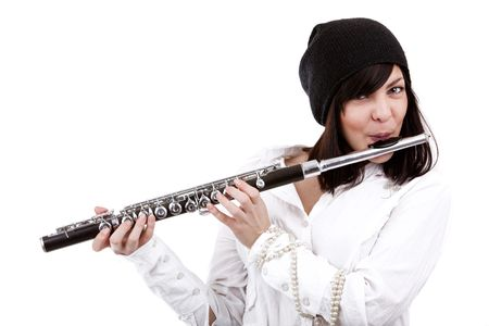 teens playing: Image of a girl playing on flute Stock Photo