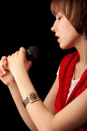 Image of a young singer with microphone photo