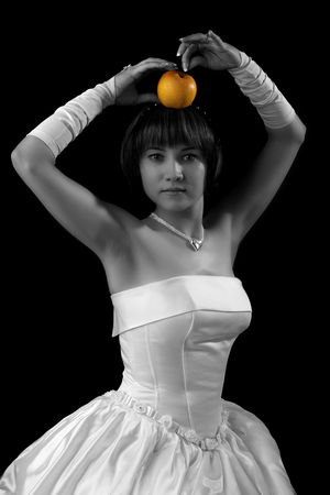 Image of a bride posing with apple photo