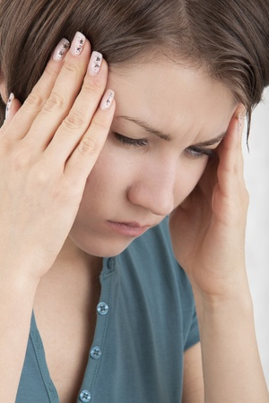 Image of a girl experiencing a headache photo