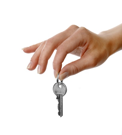 handing: Image of a womans hand holding a key