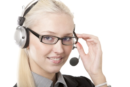 Image of a business woman in headphones on white photo