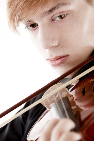 Portrait of young man playing on violin photo