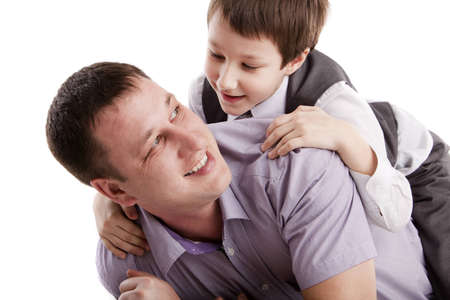 fatherhood: Father and son on a white background