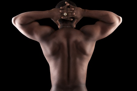 combative sport: Image of  young man on  black background