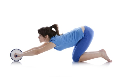Girl with a gymnastic roller on  white background photo