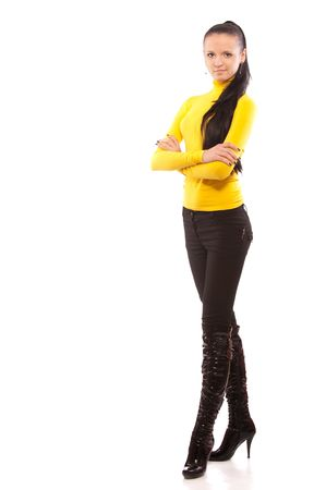 Beautiful high brunette in black boots to utmost, it is isolated on white background. photo