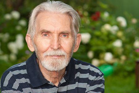 Portrait courageous seniors against summer personal plot.