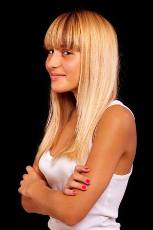 Portrait of charming girl in white vest, it is isolated on black background. Stock Photo - 6457255