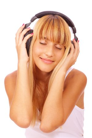 Pretty young girl listening music, isolated on white background. photo