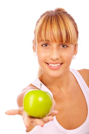 Beautiful girl with an apple, isolated on white background. Stock Photo - 6457291