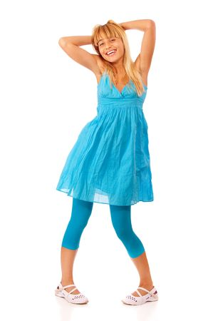 Woman in a blue dress posing, isolated on white background. photo