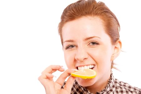 Young woman eating sour lemon, making grimace, isolated on white background. Stock Photo - 6457411