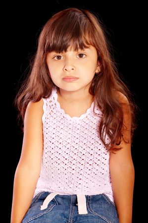 europeans: Quiet dark-haired little girl, isolated on black background. Stock Photo