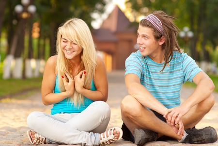 Couple outdoors sit in lotus pose Stock Photo - 6512773