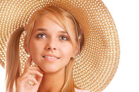 Beautiful girl wearing straw-hat portrait, isolated on white background. photo