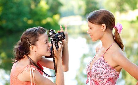 fashion shoot: Girl photographer shoot model in summer park Stock Photo