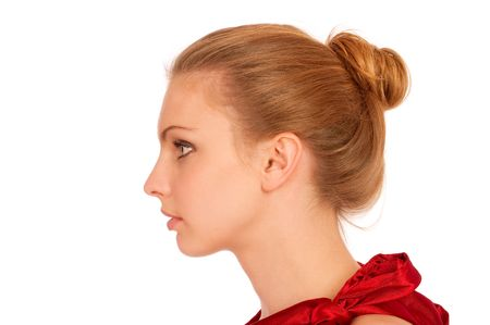 female face closeup: Profile of beautiful young woman, isolated on white background.