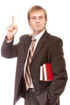 School teacher with books lifts finger upwards, isolated on white background. Stock Photo - 6610098