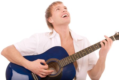 Beautiful young man plays guitar, isolated on white background. photo