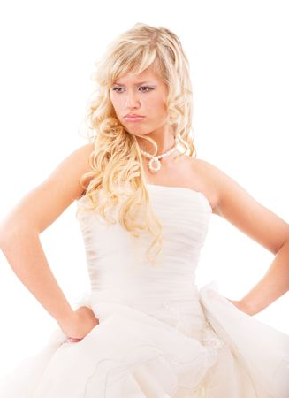 Angry bride in expectation of groom, isolated on white background. photo