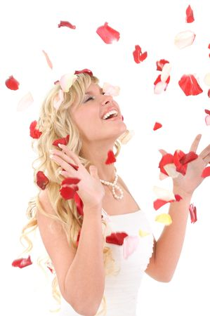 Beautiful laughing bride. On her petals of roses from above fly, isolated on white background. Stock Photo - 6610076