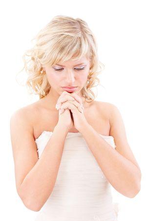 Sad bride looks downwards, isolated on white background. photo
