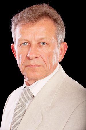 Portrait of senior business man, isolated on black background. Stock Photo - 6666193