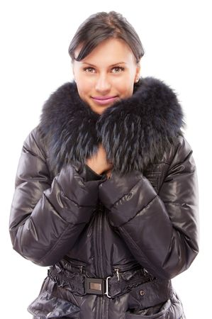 Beautiful girl in warm coat, isolated on white background. photo