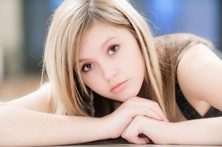 Beautiful girl against big TV photo