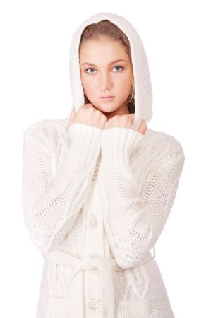 Young woman in knitted woolen sweater, isolated on white background. photo