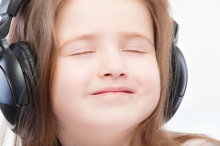 Portrait of beautiful preschool child in headphones. photo