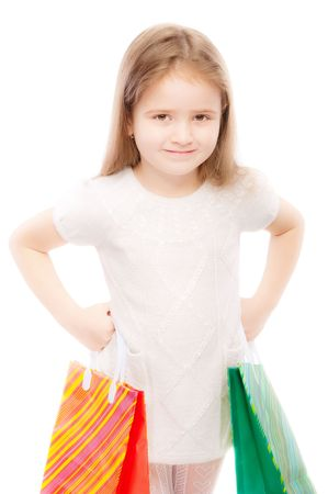 Portrait of beautiful preschool child with packages, isolated on white background. Stock Photo - 6780041