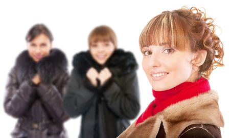 Three beautiful women in winter coats, isolated on white background. photo