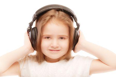 Portrait of beautiful preschool child in headphones. photo