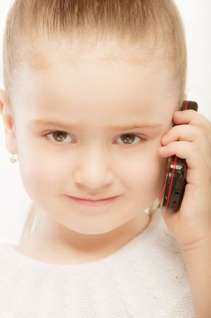 Portrait of beautiful preschool child with phone, isolated on white background. photo