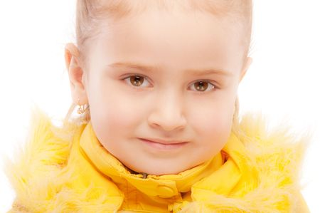 Portrait of beautiful preschool child in winter jacket, isolated on white background. photo
