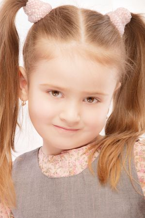 Portrait of beautiful preschool child with ponytail, isolated on white background. Stock Photo - 6780070
