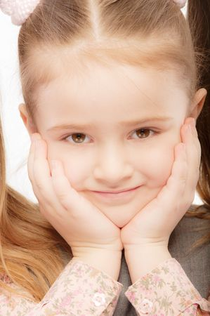 Portrait of beautiful preschool child with ponytail, isolated on white background. photo