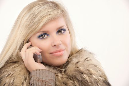 head collar: Charming blonde smiles and talks on cellular telephone.