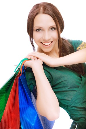 sprightly: Young beautiful smiling woman with purchases, on white background.