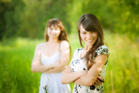 Two girls against summer nature. photo