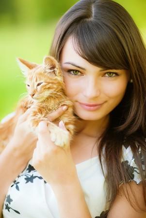head rest: Beautiful girl holds on hands of kitten. Stock Photo