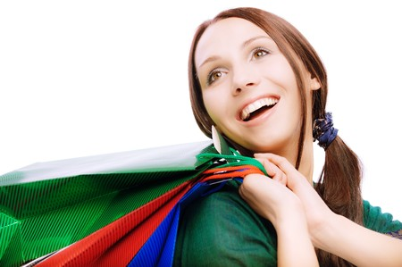 Young beautiful smiling woman with purchases, on white background. Stock Photo - 6977228