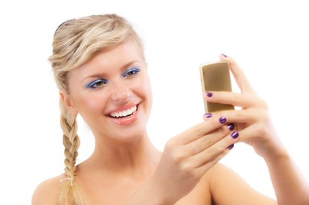 Blond young woman read sms on phone, isolated on white background. photo
