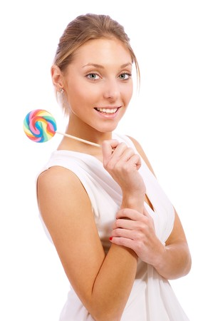 Young woman posing with lollipop, isolated on white background. photo